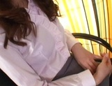 Busty office chick gives a footjob and gets sex toys in pussy