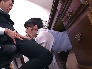 Hot secretarry gets underneath the desk and gives head