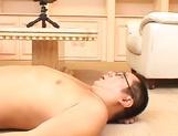 Hot Asian interviewer Ai Sayama masturbates while giving a footjob