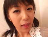 Japanese milf Nana Nanami gets filmed while sucking and fucking picture 18