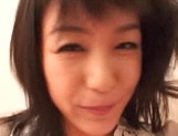 Japanese milf Nana Nanami gets filmed while sucking and fucking picture 21