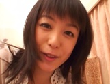 Japanese milf Nana Nanami gets filmed while sucking and fucking picture 22