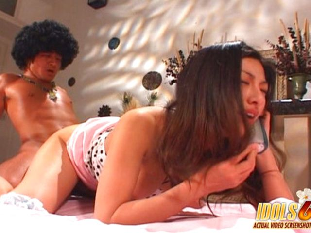 Ran Asakawa doing it doggy style and sucking cock while talking on the phone