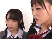 Hot Asian schoolgirls work on one large wang