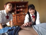 Two naughty Japanese schoolgirls share cock and ride it passionately picture 15