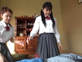 Two naughty Japanese schoolgirls share cock and ride it passionately