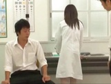 Big titted Asian doctor Mashiro Yuuna gets her shaved pussy played picture 12