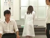 Big titted Asian doctor Mashiro Yuuna gets her shaved pussy played picture 13