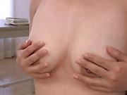 Hot milf enjoys a sensual masturbation