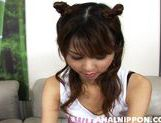 Asian girl with fancy pigtails Akira Shiratori enjoys anal plug picture 2