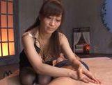 Savory Tokyo seductress makes footjob and rides rod