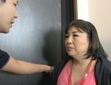 Chubby Japanese mature gets fucked by a strong hunk