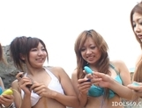 Shiho and her hot Japanese friends enjoy their toys on the beach