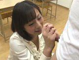 Sexy teacher Kanari Tsubaki does hand work on hard cock