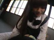 Asian teen in black stockings enjoys giving a blowjob