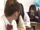 Yummy Japanese lesbian teens involve a classmate into a kinky game picture 5