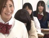Yummy Japanese lesbian teens involve a classmate into a kinky game picture 6