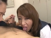 Two crazy Japanese teachers in black stockings share and ride cock