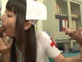 Tsubomi naughty Asian nurse gives double blow jobs picture 11