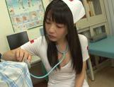 Tsubomi naughty Asian nurse gives double blow jobs picture 1