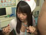 Tsubomi naughty Asian nurse gives double blow jobs picture 8