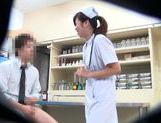 Horny Japanese nurse seen by secret spy cam picture 11