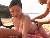 Attractive beach queen Minako Komukai has threesome sex outdoors picture 9