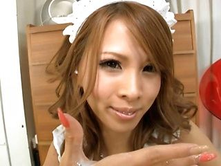 Sensual Asian maid Ema Kisaki enjoys jerking off her client