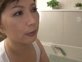 Reiko Shimura naughty mature babe is in the tub, gets tits fucked picture 15
