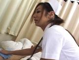 Erena Fujimori Asian nurse gives a hot blowjob picture 14