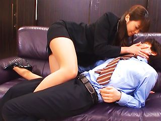 Maki Hokujo hot office babe gives Asian footjob