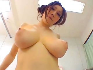Lovely Japanese milf with huge boobs shows them off