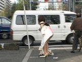 Lovely Asian doll is a sexy flashing babe on the street picture 12