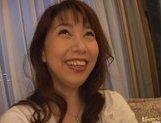 Mature Asian lady gets a cum facial picture 14