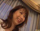 Mature Asian lady gets a cum facial picture 15