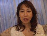 Mature Asian lady gets a cum facial