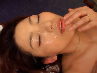 Mature Asian lady gets a cum facial