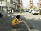 Sweet Asian girl exposes her fine ass on the street picture 2