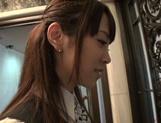 Naughty Asian office lady Shizuku Memori gives a cute foot job picture 12