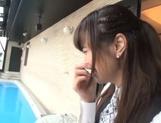 Naughty Asian office lady Shizuku Memori gives a cute foot job picture 15