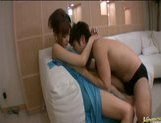 Asian gal rides on a hard cock from the rear