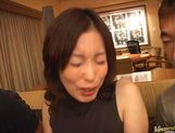 Mature Asian model is into bukkake picture 8