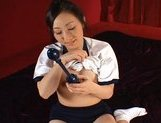 Japanese AV model fondles her juicy pussy