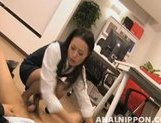 Tempting office lady Mai Mizusawa gives a footjob on Asian anal porn
