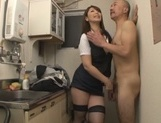 Attractive mature chick in fishnet stockings has sex in a kitchen