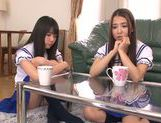 Two Asian schoolgirls share thick rod and ride it hard picture 3