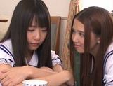 Two Asian schoolgirls share thick rod and ride it hard picture 4