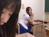 Two Asian schoolgirls share thick rod and ride it hard picture 5