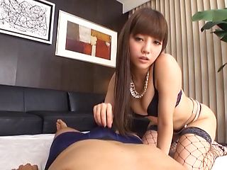 Young Asian cutie Maeri Konno in nice lingerie and fishnet stockings plays with cock