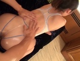 Busty babe with bubble ass, Naho Yuumi gets oiled and pounded picture 14